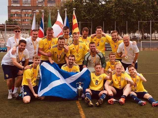 Greig (1st left) with Scotland cerebral palsy team squad after winning their first ever tournament in Barcelona last year without conceding a goal.