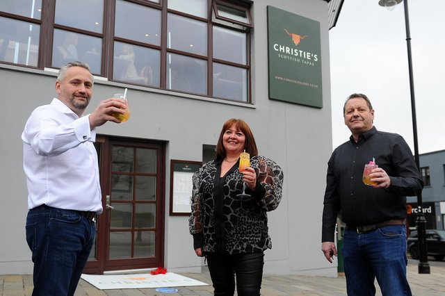 Christie's, Falkirk's new Scottish tapas restaurant, held a launch night featuring a piper and ribbon cutting ceremony by Barbara Bryceland. Pictured: David Blackwood, owner; Yvonne Latta, business partner; and Tom Malloy, owner. Picture: Michael Gillen.