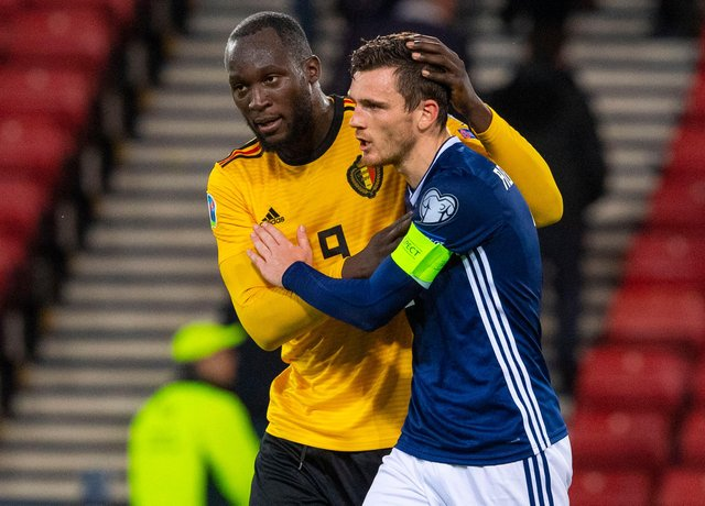 GLASGOW, SCOTLAND - SEPTEMBER 9: Scotland's Andy Robertson is consoled by Romelu Lukaku at full time during a UEFA Euro 2020 qualifier between Scotland and Belgium, at Hampden Park, on September 9, 2019, in Glasgow, Scotland. (Photo by Alan Harvey / SNS Group)