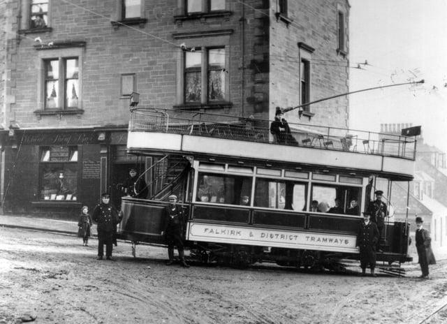 A tram at Larbert Cross outside the Wheat Sheaf Bar around 1905.