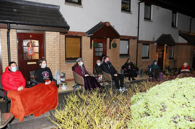 Neighbours of Craig Eddie watch him live in The Voice 2021 final on a big screen.