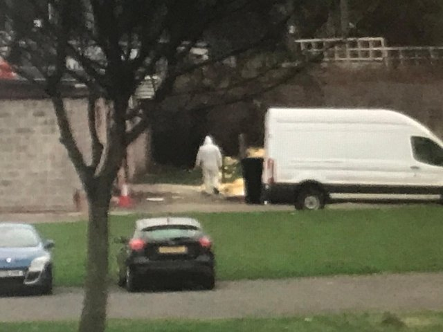 Workers dispose of the refuse at the rear of Camelon Labour Club