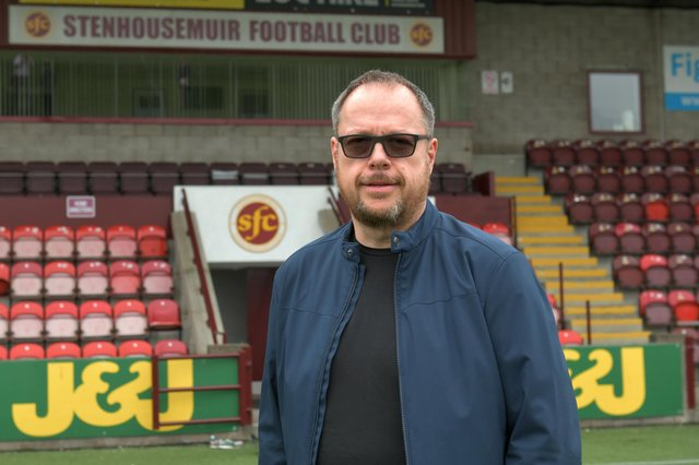 David Smith oversees Stenhousemuir FC's Blether Together telephone befriending service. Picture: Michael Gillen.