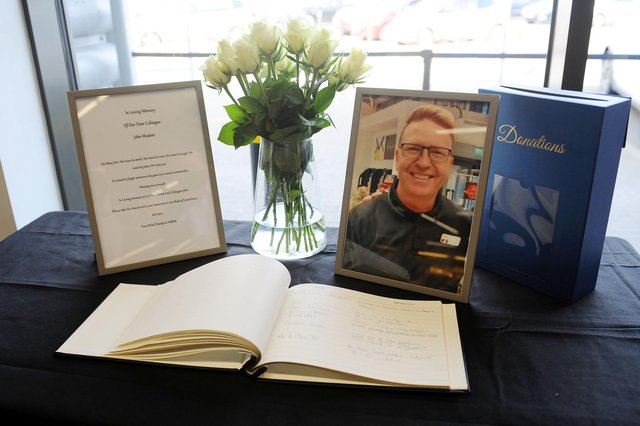 M&S Foodhall in Falkirk's Central Retail Park has set up a book of condolences for former employee John McAleer following his sudden death last week. Picture: Michael Gillen.