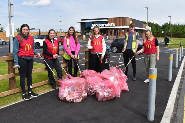 McDonald's staff pick litter at Camelon