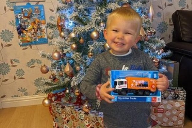Ollie McEwan, 2,  from Falkirk with his gift of a toy bin lorry from the crew which he waves to every day