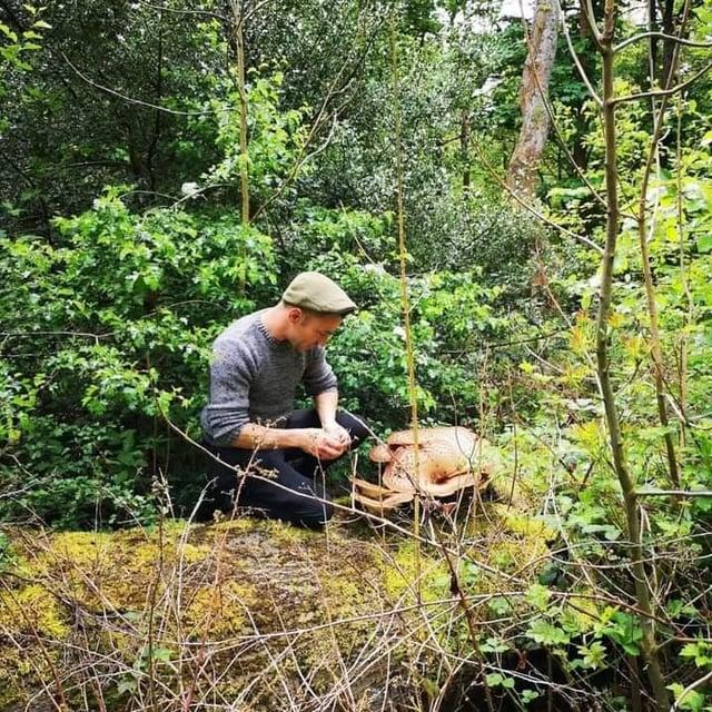 Gerard foraging for mushrooms