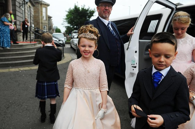 The royal retinue arrive in limos at Grangemouth Town Hall for the crowning ceremony