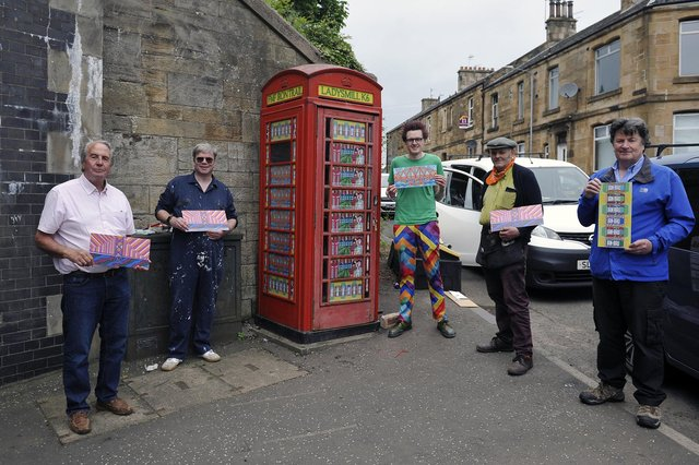 Edinburgh-based artist RichardDuffy with Falkirk Made Friends members beside an old K6 phone box at Ladysmill Bridge, Falkirk which was made in Carron Ironworks. Pictured with the phone box are Bill Paterson, FMF member; John, a fellow FMF member; artist, RichardDuffy; Duncan Comrie, FMF secretary; and Robert Bissett, FMF chairman. Picture: Michael Gillen.