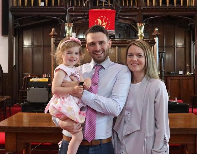 Reverend Andrew Brown at Craigmailen Church with his wife and daughter.