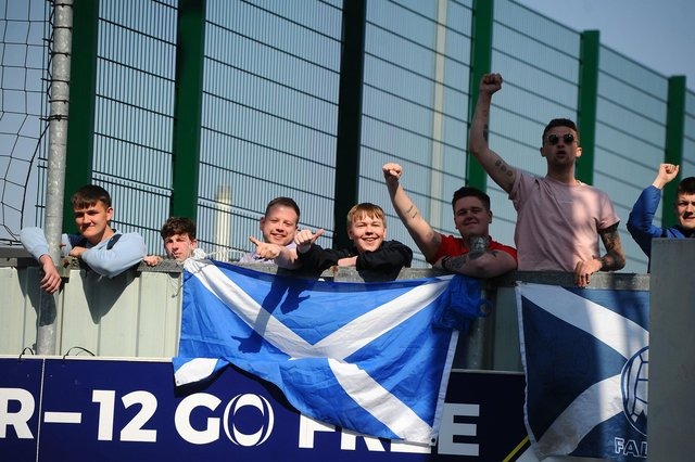 Falkirk fans, still not allowed in to the stadium due to the ongoing restrictions, watch from over the wall