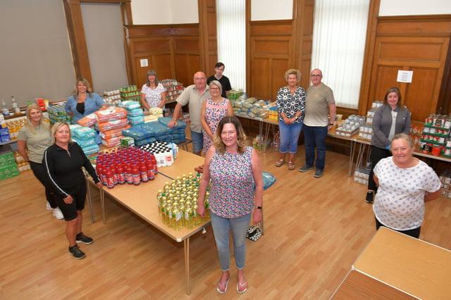Keeping Larbert and Stenhousemuir Beautiful volunteers received funding through Stenhousemuir FC's Community Helpline Initiative to support its pantry operation. Picture: Michael Gillen.