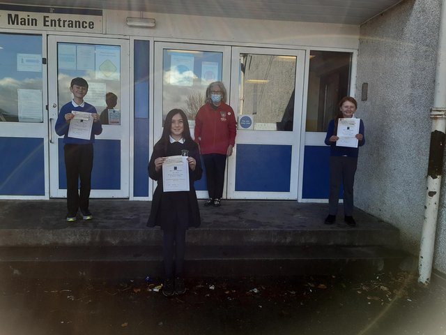Wallacestone Primary School pupils Alice Ohlstenhius, Holly Curtis and Matthew Savage receive their prizes for this year's Falkirk Rotary Club young writers competition