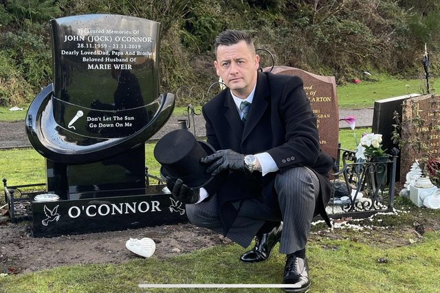 Steven O'Connor at his father's grave with the one-of-a kind headstone in Camelon Cemetery