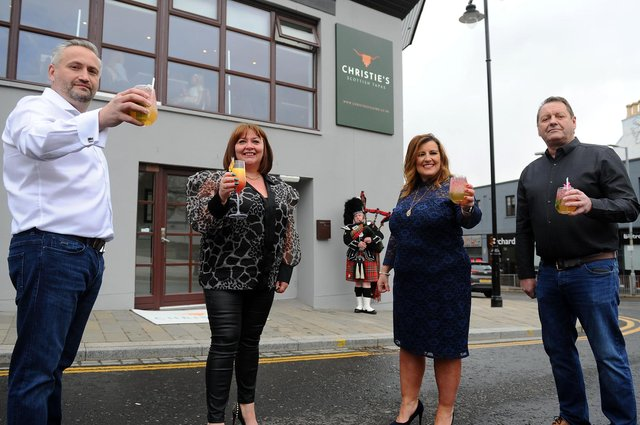 Scottish tapas restaurant Christie's launched in Falkirk on Wednesday. Pictured are owner David Blackwood, business partner Yvonne Latta, fellow owner Tom Malloy and singer Barbara Bryceland (centre, right). Picture: Michael Gillen.
