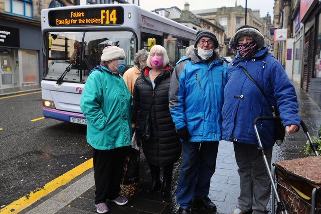 Helen Flynn wearing a pink mask with other bus users pictured six months ago (Pic: Michael Gillen)