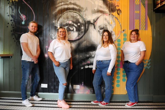 Sal's staff Blair Nisbet, supervisor; Indiana Aitken, manager; Chelsea MacDonald, assistant manager; and Leda Sweeney, head cook. Mural by Michael Corr. Picture: Michael Gillen.