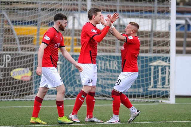 Blair Alston celebrates Falkirk's second goal with Callumn Morrison and Aidan Keena