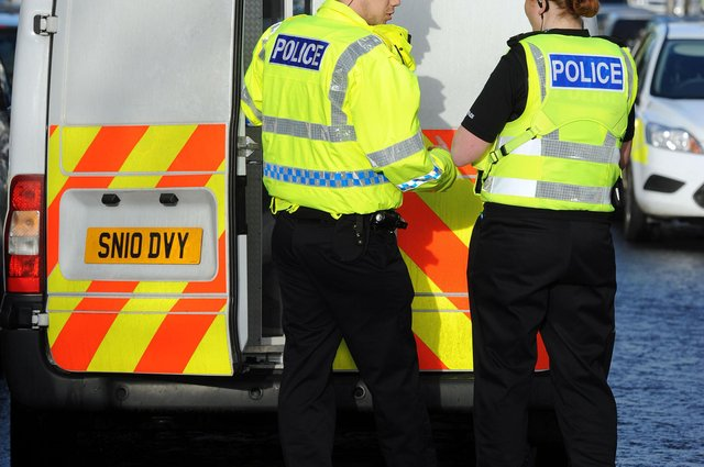 Police are hunting a bogus workman who targeted an elderly resident in Stenhousemuir