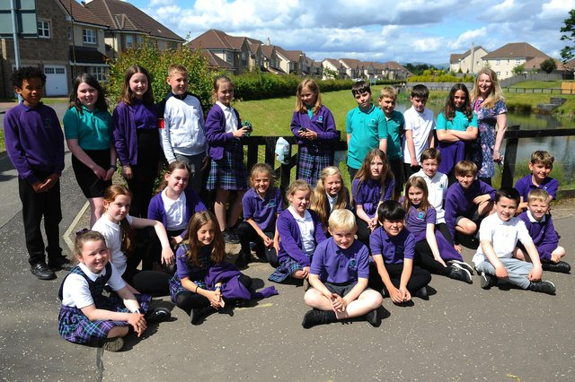 Kinnaird Primary School's P5L class, led by Ms Caryll Jack, has launched a campaign designed to tackle littering and an issue with tied and discarded bags of dog faeces in the Larbert area. Picture: Michael Gillen.