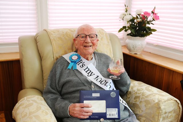 John William Boot, known as Jack, celebrates his 100th birthday with his tot of brandy - one of the secrets of his long life