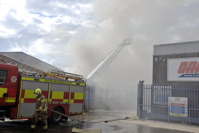 Firefighters at the scene at Angus Braidwood and Son Ltd on Castle Drive.  Bankside Road and Abbots Road were closed to vehicles.(Pic: Michael Gi8llen)