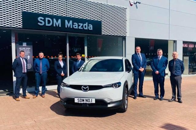 SDM Mazda wins  'Dealer of the Year'  - from left Steven Learmonth, Lewis Wood, Helen Aitken, Brett Hague (Mazda UK head of network strategy), Peter Alibon (Mazda UK sales director), Niall Syme and John Mallis