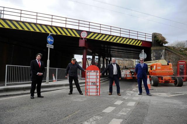 Falkirk Made Friends members Robert Bissett, chairman; Duncan Comrie, secretary; Bill Paterson; and John Fotheringham beside the refurbished Ladysmill Bridge. Picture: Michael Gillen.