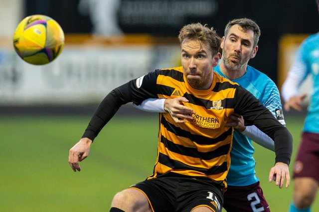 New Stenhousemuir signing Robert Thomson holding off Michael Smith during a Scottish Championship match between Alloa Athletic and Heart of Midlothian in January 2021 (Photo by Bruce White/SNS Group)