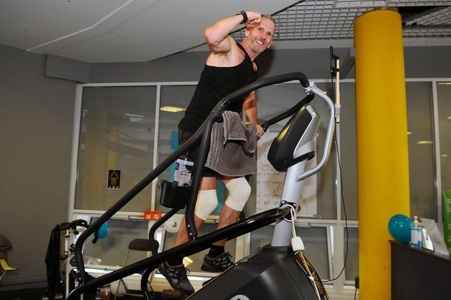 Dave Lawrence climbed the equivalent height of Mount Everest on a Stairmaster machine at a Falkirk gym for Strathcarron Hospice. Picture: Michael Gillen.