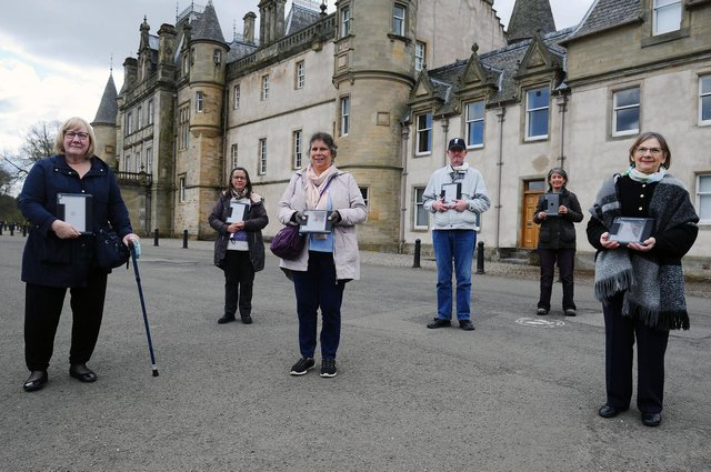 Music directors Kim Edgar andMariot Dallas presented members with iPads, awarded through the Connecting Scotland scheme. Picture: Michael Gillen.