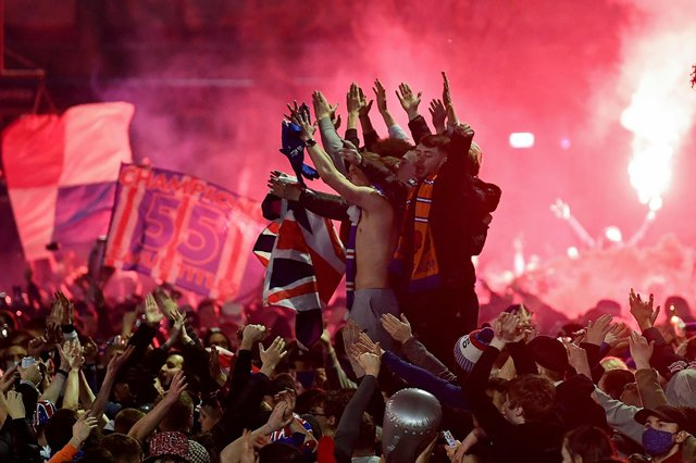 Rangers fans gather in George Square to celebrate the club winning the Scottish Premiership for the first time in 10 years (Photo by Jeff J Mitchell/Getty Images)
