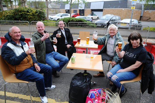 Customers enjoy a drink outside The Courtyard in Falkirk. Picture: Michael Gillen.