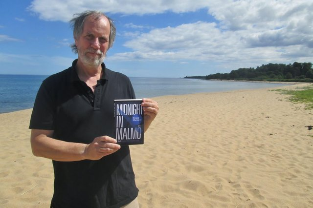 Author Torquil MacLeod on Anita's holiday beach for the launch of the fourth book in the series, Midnight in Malmo