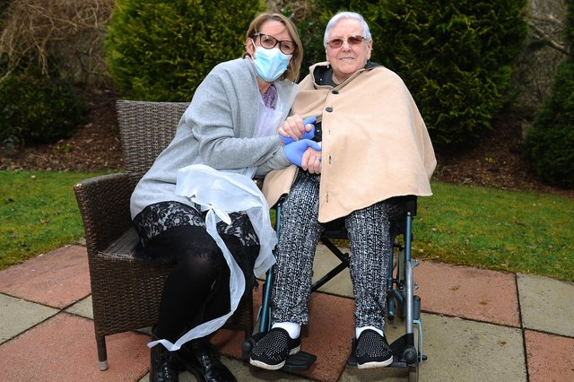 Anne Lake visiting her mum Lily Waugh at Carrondale Care Home, Carron. Photographs taken outside as only essential visitors are permitted inside. Picture: Michael Gillen.