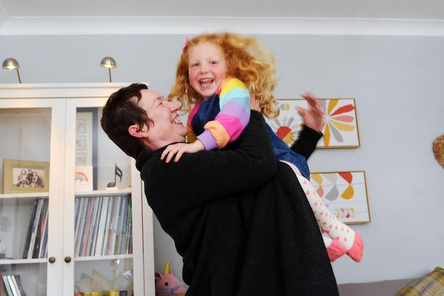 In Laurieston, friend and neighbour, Moira Holland visits Angela Will and Philip Roder and their childrenEmmi Roder 4 andEloisa Roder 2, indoors for the first time since lockdown. Moira's visit was tocongratulate Angela and Philip on their engagement last week. The couple hope to marry in 2022.Pictured Moira Holland and Emmi Roder 4 (Pic: Michael Gillen)