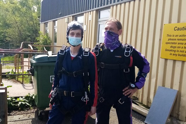 Carrondale Care Home chef Nikos Kokkoris (left) completed a skydive over Fife Airport to help fund a wheelchair-adapted minibus for the facility. Contributed.