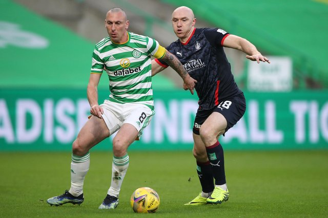 Celtic's Scott Brown being challenged by Falkirk's Conor Sammon during their sides' Scottish Cup third-round match today in Glasgow (Photo by Ian MacNicol/Getty Images)