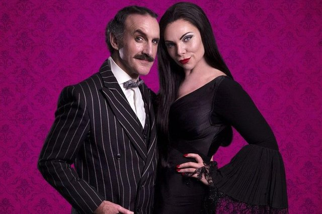 Cameron Blakely and Samantha Womack as Morticia and Gomez Addams