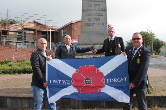 John McAleese MM Commemoration Society members, including John's twin brother William (back left). Picture: Snaphammy Photography.