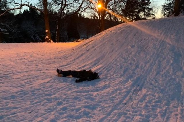 Nothing better than lying down in the snow! (Picture:  Homefront Signs)