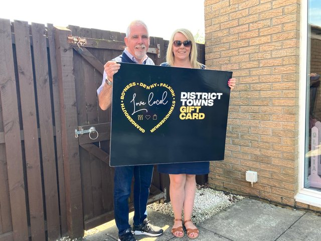 Charlie Allan and daughter Cheryl Hogarthwith the Falkirk District Towns Gift Card she nominated him to receive