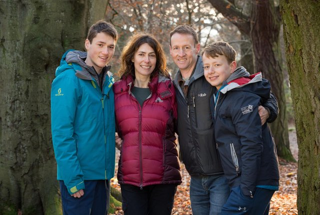 Rob Flett,  with his wife Moira and sons Jamie and Euan (Pic: Paul )