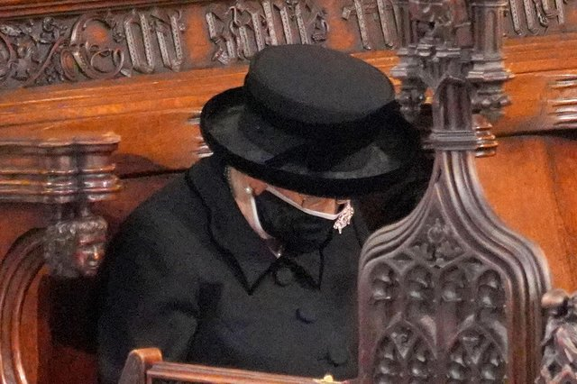 The Queen bows her head during the funeral of the Duke of Edinburgh