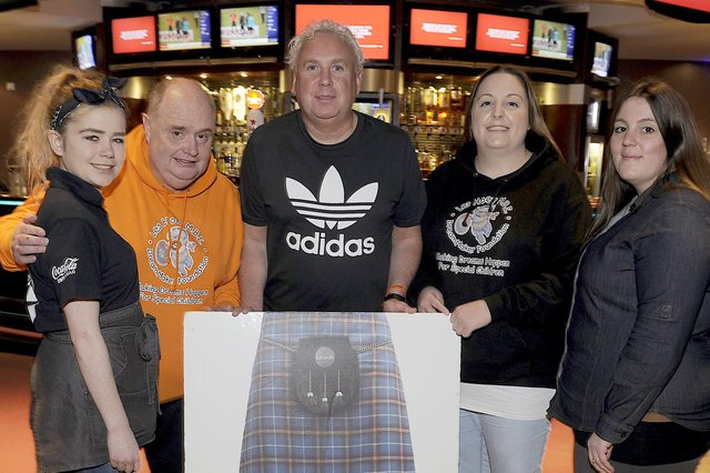 Gus Michael (centre), DJ at Sportsters in Falkirk, says he and fellow staff have received little financial assistance from the Scottish Government amid the coronavirus pandemic. Picture: Michael Gillen.