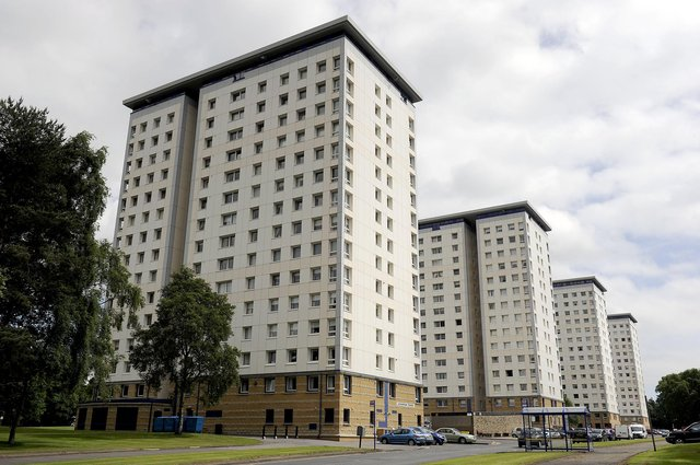 McIntyre was seen by police to dangle his feet out of the window sill  of his 13th floor flat in Falkirk's Marshall Tower