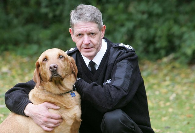 Scottish SPCA Chief Superintendent Mike Flynn with Monty the Golden Labrador