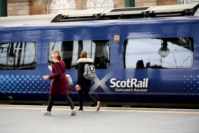 Passengers board a ScotRail train at Glasgow Central Station picture: John Devlin