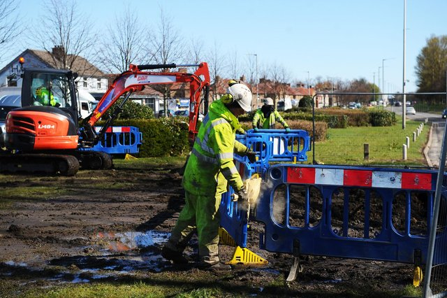 The Scottish Water team work to repair the burst water main in Dalgrain, Grangemouth