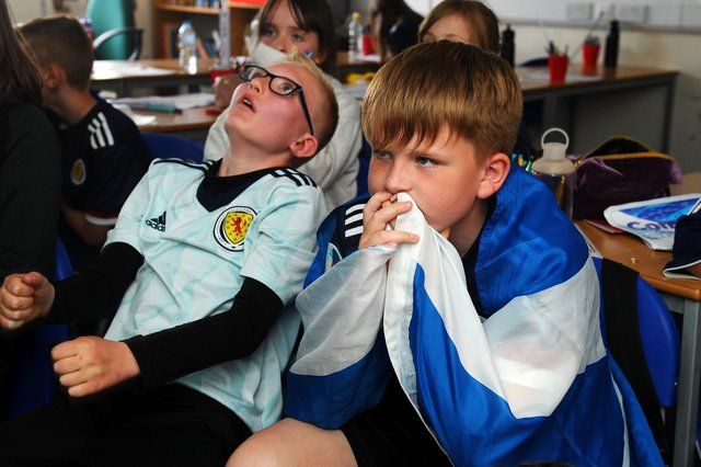 P6B pupils at Denny Primary got to watch the opening gamer today ... but it didn't end well as the Scots went down to defeat. (Pic: Michael Gillen)